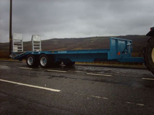 blue low loader on tractor
